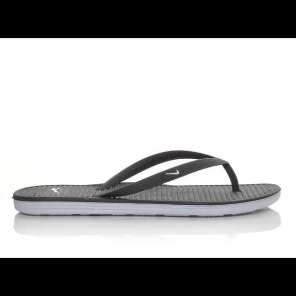 f683f7200bdef5 Women s Nike Solarsoft Flip Flops. M 5a90a92150687cc287435d9f